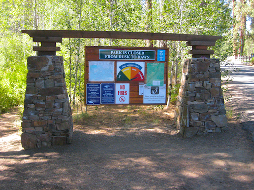 Shevlin Park information bulletin board, this attractive sign serves as the start of the Shevlin Park loop trail.
