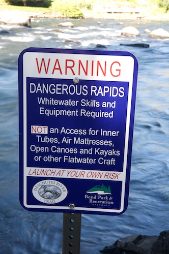 Whitewater warning sign